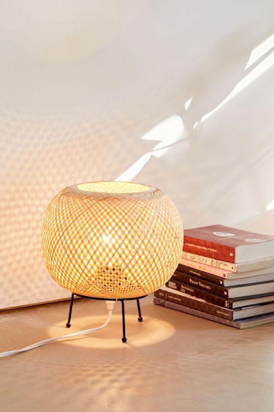 https_%2F%2Fblogs-images.forbes.com%2Fforbes-finds%2Ffiles%2F2019%2F03%2FUrban-Outfitters-Alina-Rattan-Table-Lamp-.jpg